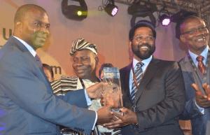 Dr Oko Vanderpuije (right) receiving the Accra award from President Eduardo dos Santos.