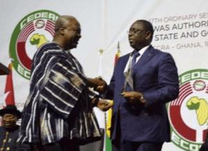 President Mahama handing over to President Sall
