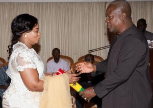Mrs. Osei (left) being sworn in by the President, John Mahama