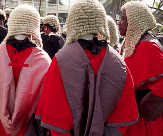 Of justice, the cedi and the rule of law